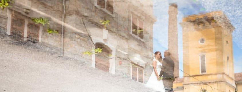 Giorgia Davide Matrimonio Villa Revoltella Salvia Rosmarino Trieste ritratti sposi Porto Vecchio Magazzino 26 pozzanghera riflesso