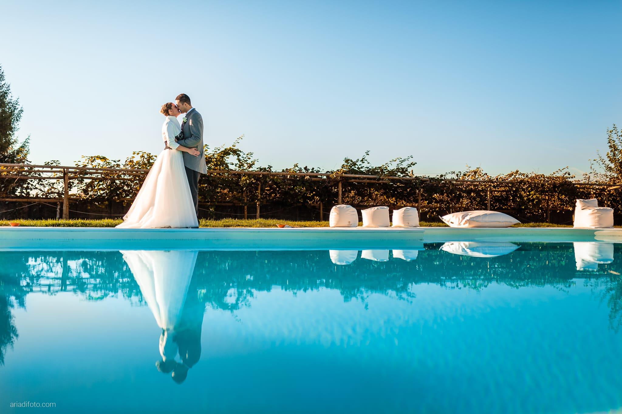 Laura Daniele Matrimonio San Vito Al Tagliamento Villa Faggiotto Busco Ponte Piave Treviso ritratti sposi piscina